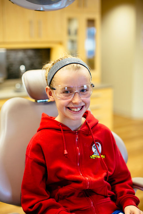 girl patient in red smiles